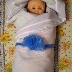 Як сповивати дитини в ковдру - три різні способи з покрокової фотоінструкцію